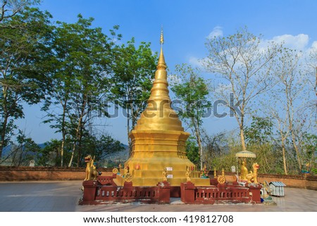 Golden pagoda in a small temple in Thailand, temple, religion, pagoda.