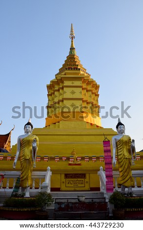 golden pagoda in Chiang Saen, Chiang Rai, northern of Thailand, blue sky, blue sky cloud   - stock photo