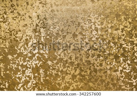golden panel with some fine grain and texture highlight in it - stock photo