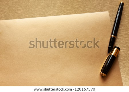 golden paper background and pen