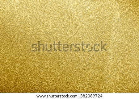 Golden paper foil on background texture. - stock photo