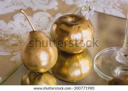 golden pear and apple - stock photo