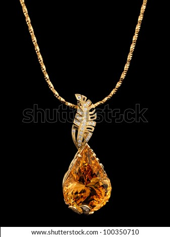 Golden pendant with gem and diamonds on black - stock photo