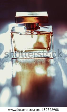 Golden perfume bottle - stock photo