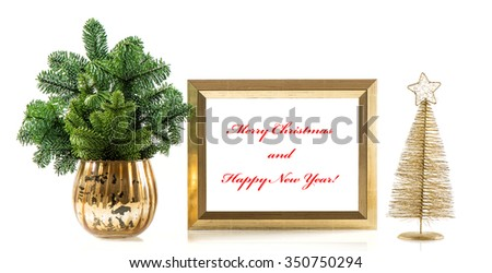 Golden picture frame with decoration and christmas tree branches. Holidays banner with sample text Merry Christmas and Happy New Year! - stock photo
