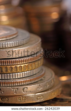golden piles of coins closeup