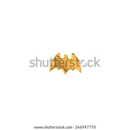 Golden plastic bat man icon. Isolated on a white background. - stock photo