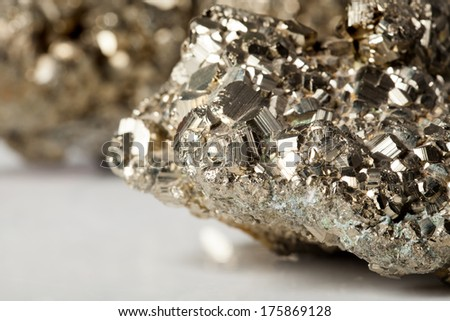 Golden pyrite stone specimen with shiny reflections - stock photo