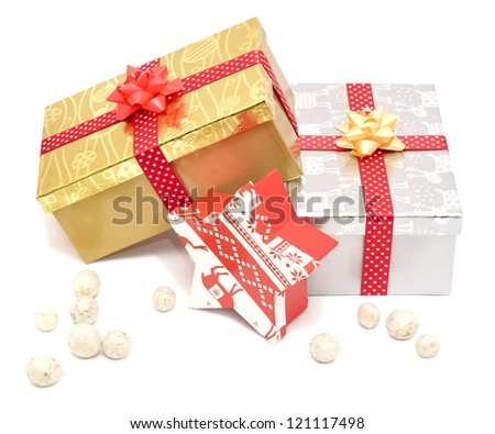 Golden red and silver gift boxes with ribbons isolated on white background