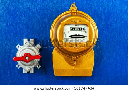 Golden retro electric meter with toggle switch   - stock photo