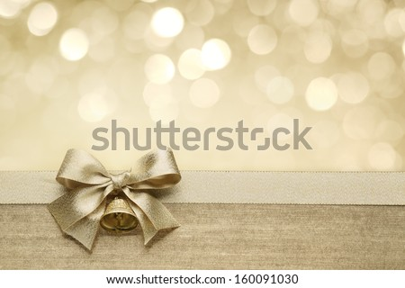 Golden ribbon bow with bokeh,Christmas decoration.