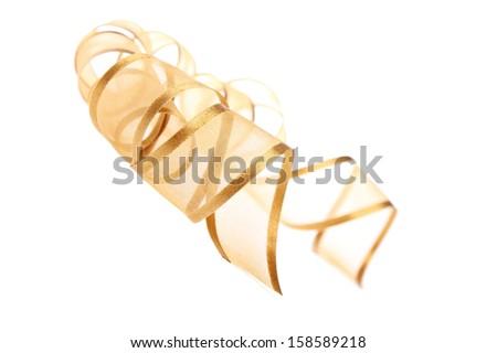Golden ribbon on the white background - stock photo