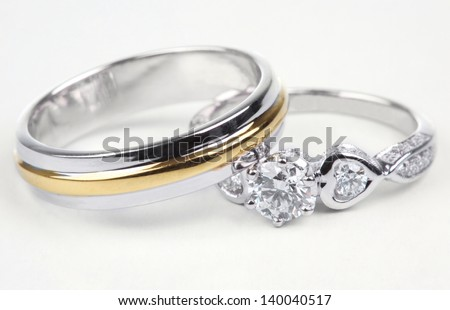 Golden ring and contemporary diamond ring, Isolated on white background.