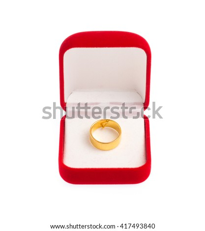 Golden ring on Red velvet box isolated on white background - stock photo