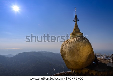 Golden rock Kyaikhtiyo pagoda in sunshine, Myanmar   - stock photo
