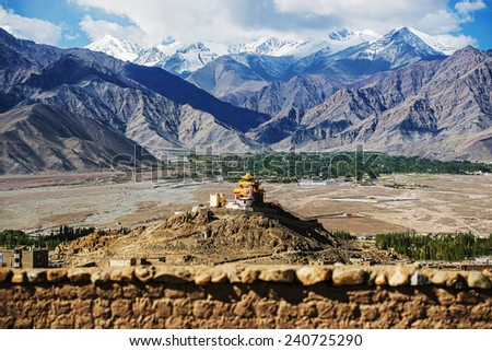 Golden roof monastery and snow mountain range Leh Ladakh ,India - September ,2014 - stock photo