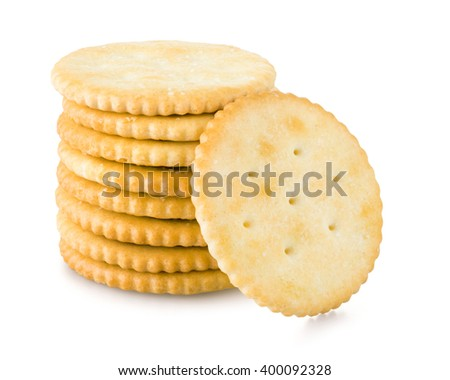 Golden round crackers over white background