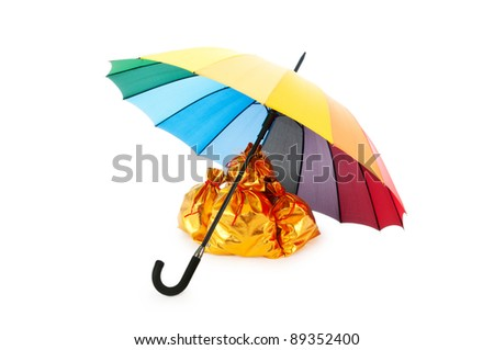 Golden sacks under umbrella