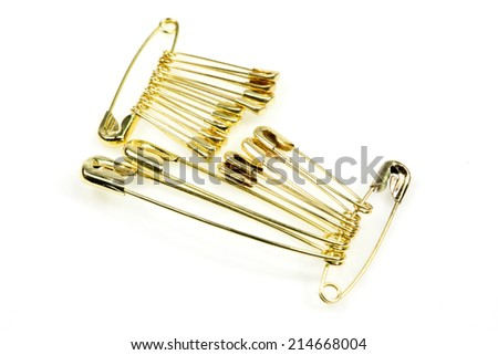golden safety pin  - stock photo