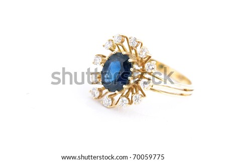 golden sapphire ring isolated against a white background - stock photo