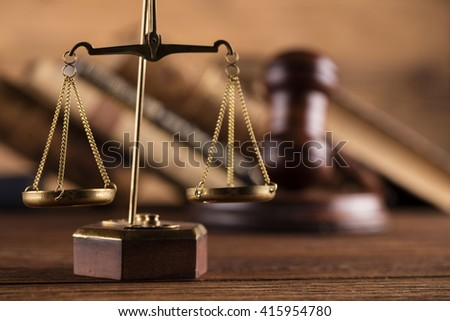 Golden scales of justice, gavel and books on brown background Law code, gavel and books. - stock photo