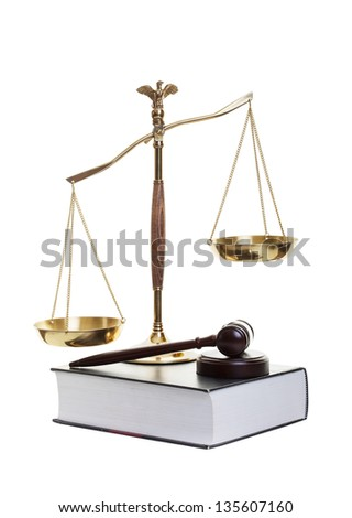 Golden scales of justice, gavel and law book on a white background