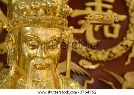 golden sculpture in temple - stock photo