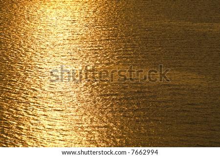 Golden sea in the sunset evening light. Jutland, Denmark - stock photo
