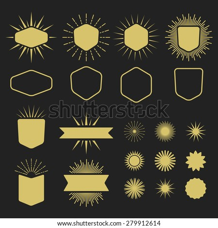 Golden set of empty design elements on black background - Badges, emblems, sunburst, ribbons, banners, and stars - stock photo