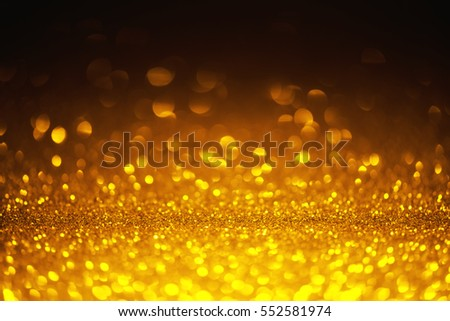 Golden shiny glitter lights bokeh background
