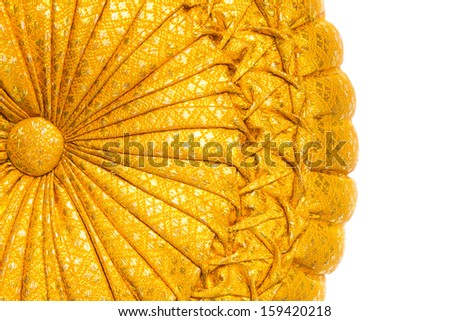 Golden shiny pillow isolated on white - stock photo