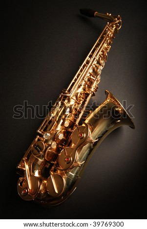 golden shiny saxophone on black background