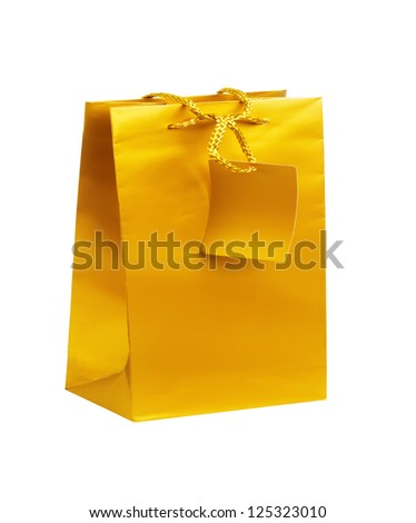 Golden shopping bag isolated on white background