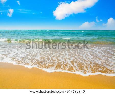 golden shore and blue sky in Sardinia, Italy - stock photo