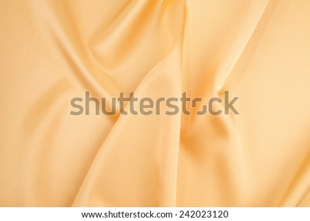 Golden silk drapery. Isolated as a whole background.  - stock photo