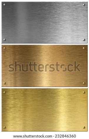 Golden, silver and copper metal plates set isolated - stock photo