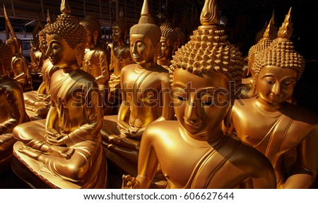 Golden sitting buddha statues in tthe thailand temple, Bangkok