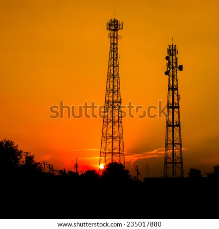Golden sky with telecommunication tower - stock photo