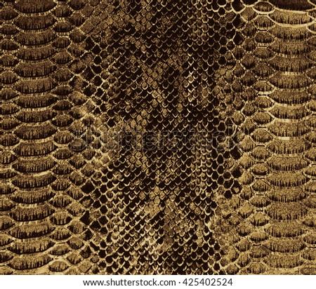 Golden snake skin background  - stock photo
