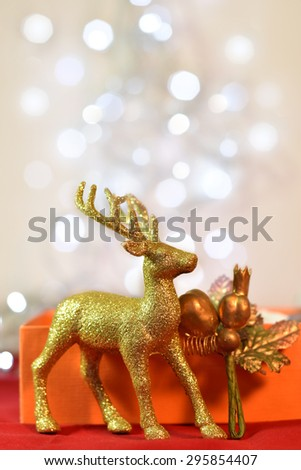 Golden Stags and Christmas decorations. Background bokeh