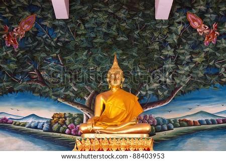 Golden standing Buddha statue - stock photo