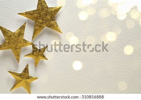 Golden star on festive background - stock photo