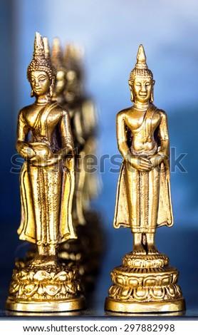golden statue Buddha decorative religion - stock photo