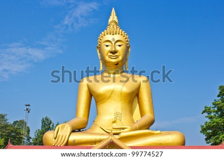 Golden Statue of Buddha in Thailand and blue sky