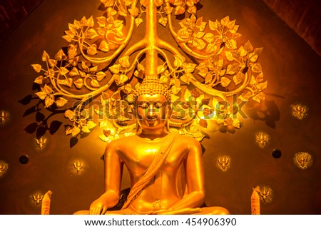 Golden statue of Buddha meditation on the altar quiet. - stock photo