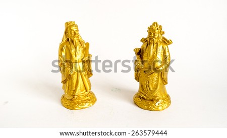 Golden statue of Chinese deities called Fu Lu Shou or Three Stars God. Concept of blessings, prosperity and longevity. Shot with natural light. Slightly defocused and close-up shot. Copy space. - stock photo