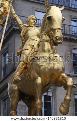 Golden statue of Joan of Arc in Paris - stock photo