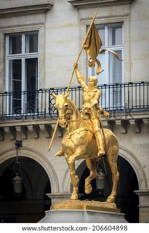 Golden statue of Joan of Arc on horseback  in Paris - stock photo