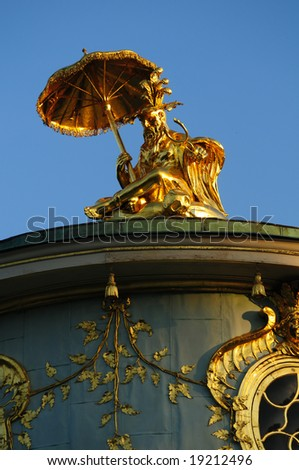 "golden statue on top of the ""Chinese Pavilion"" in Potsdam, Germany"