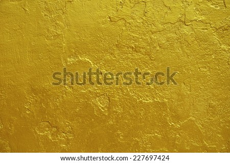 golden statue painted cracked texture - stock photo